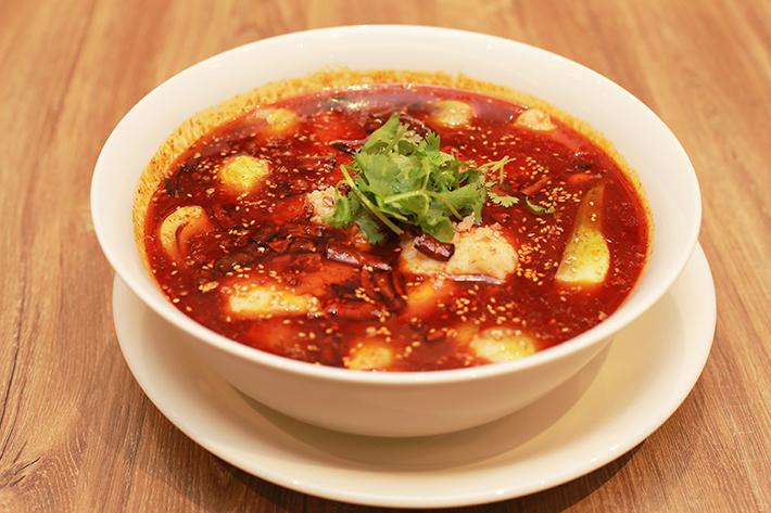 Crystal Jade La Mian Xiao Long Bao Poached Fish in Szechuan Spicy Soup