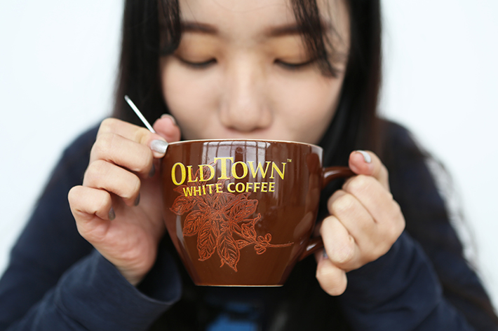 Old Town White Coffee Drinking Shot 2