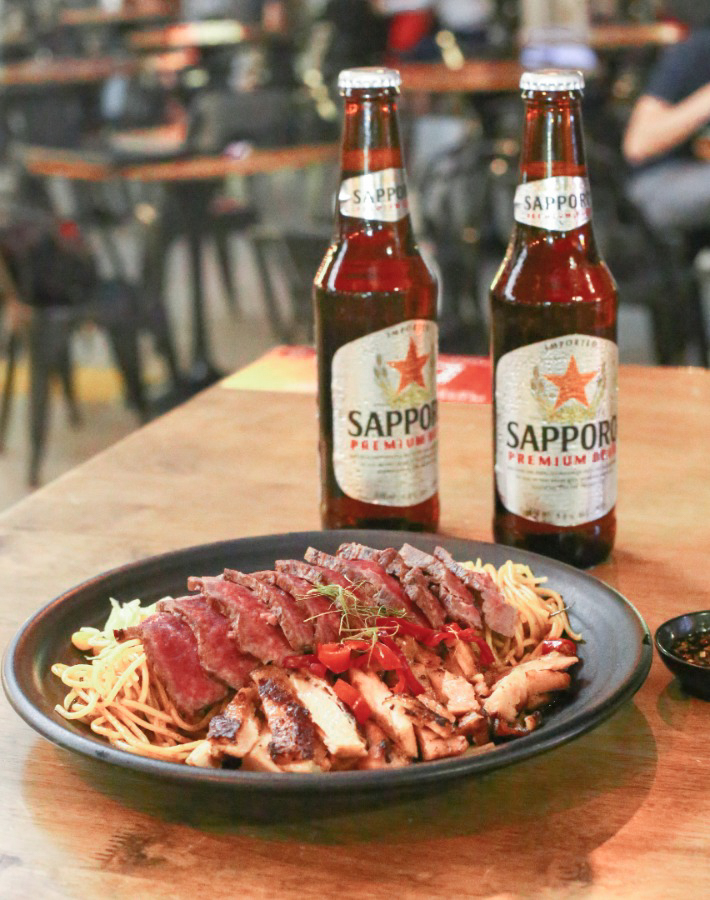 Tom Yum Pasta with Steak and Sapporo Beer